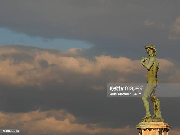 David Statue Against Dramatic Sky