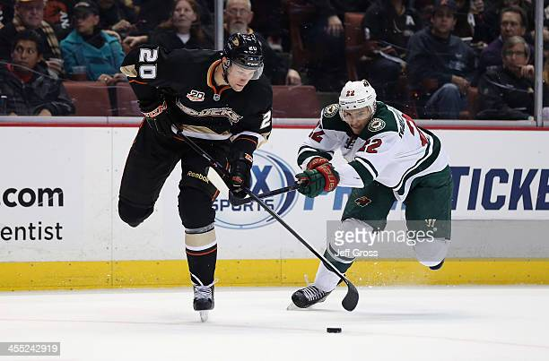David Steckel of the Anaheim Ducks is pursued by Nino Niederreiter of the Minnesota Wild for the puck in the first period at Honda Center on December...