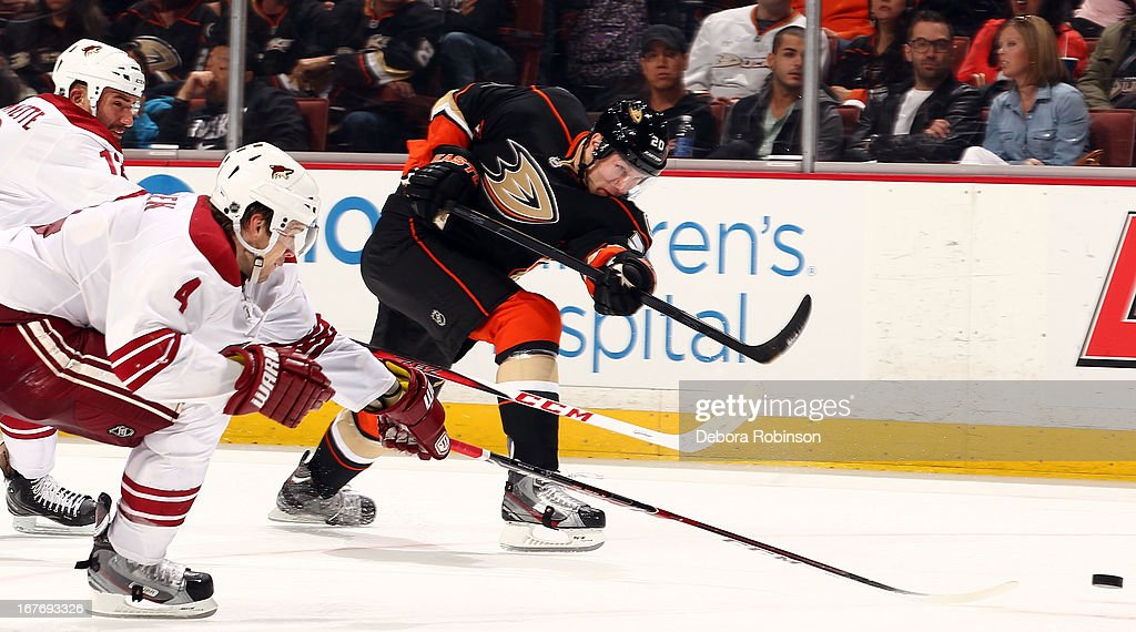 <a gi-track='captionPersonalityLinkClicked' href=/galleries/search?phrase=David+Steckel&family=editorial&specificpeople=685812 ng-click='$event.stopPropagation()'>David Steckel</a> #20 of the Anaheim Ducks shoots the puck against <a gi-track='captionPersonalityLinkClicked' href=/galleries/search?phrase=Zbynek+Michalek&family=editorial&specificpeople=243230 ng-click='$event.stopPropagation()'>Zbynek Michalek</a> #4 of the Phoenix Coyotes during the game on April 27, 2013 at Honda Center in Anaheim, California.