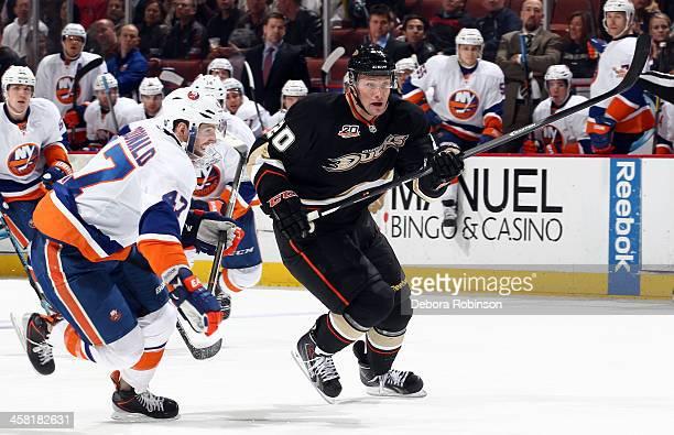 David Steckel of the Anaheim Ducks skates against Andrew MacDonald of the New York Islanders on December 9 2013 at Honda Center in Anaheim California