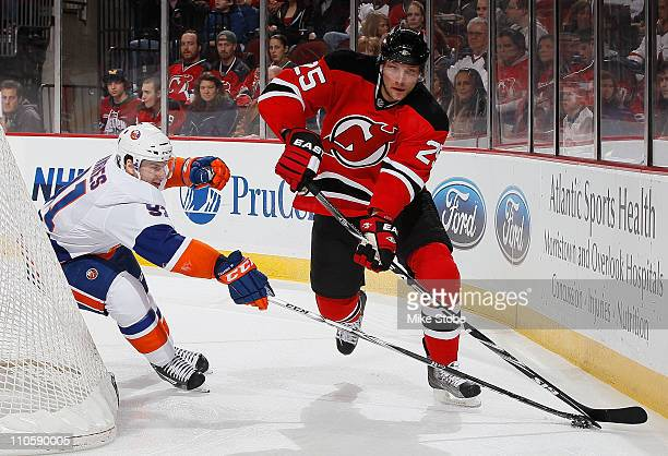 David Steckel of the New Jersey Devils skates against John Tavares of the New York Islanders on March 12 2011 at the Prudential Center in Newark New...
