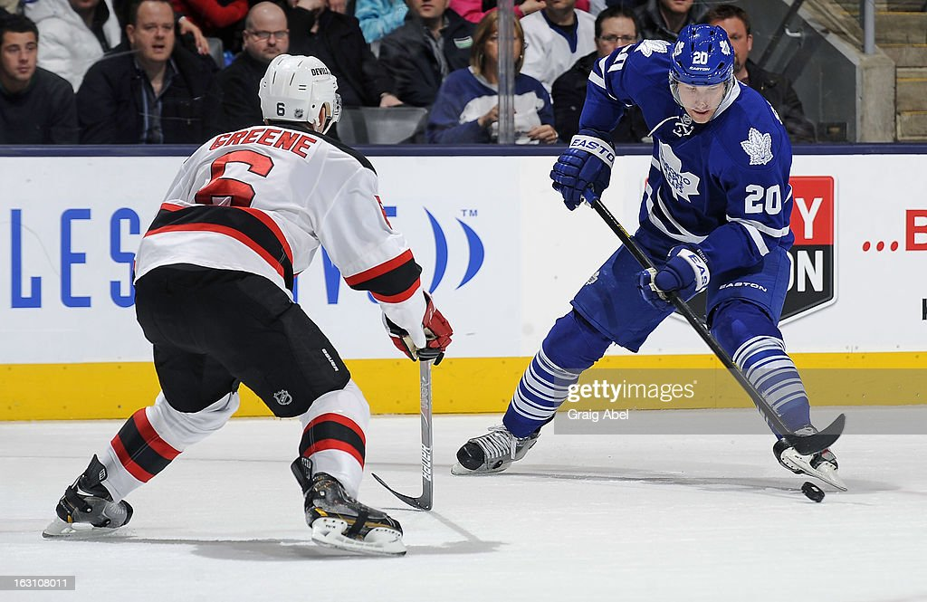 <a gi-track='captionPersonalityLinkClicked' href=/galleries/search?phrase=David+Steckel&family=editorial&specificpeople=685812 ng-click='$event.stopPropagation()'>David Steckel</a> #20 of the Toronto Maple Leafs skates with the puck as <a gi-track='captionPersonalityLinkClicked' href=/galleries/search?phrase=Andy+Greene&family=editorial&specificpeople=3568726 ng-click='$event.stopPropagation()'>Andy Greene</a> #6 of the New Jersey Devils defends during NHL game action March 4, 2013 at the Air Canada Centre in Toronto, Ontario, Canada.