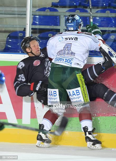 David Steckel of Thomas Sabo Ice Tigers and Mark Cundari of Augsburger Panther during the Gaeuboden Cup game between Thomas Sabo Ice Tigers and...