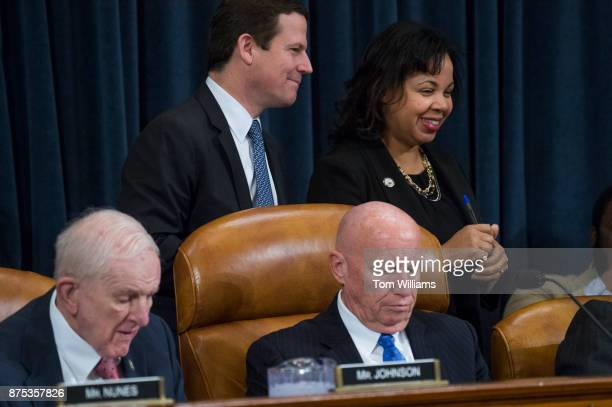 David Stewart background at left Republican Ways and Means Committee staff director and Karen McAfee Democratic staff director are seen with Chairman...