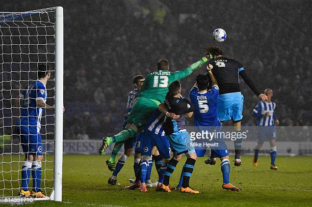David Stockdale of Brighton Hove Albion punches clear from Atdhe Nuhiu of Sheffield Wednesday during the Sky Bet Championship match between Brighton...