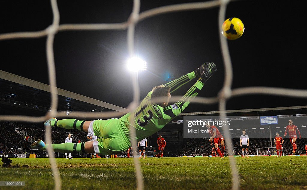 David Stockdale of Fulham dives as <a gi-track='captionPersonalityLinkClicked' href=/galleries/search?phrase=Steven+Gerrard&family=editorial&specificpeople=202052 ng-click='$event.stopPropagation()'>Steven Gerrard</a> of Liverpool scores their third goal from the penalty spot during the Barclays Premier League match between Fulham and Liverpool at Craven Cottage on February 12, 2014 in London, England.