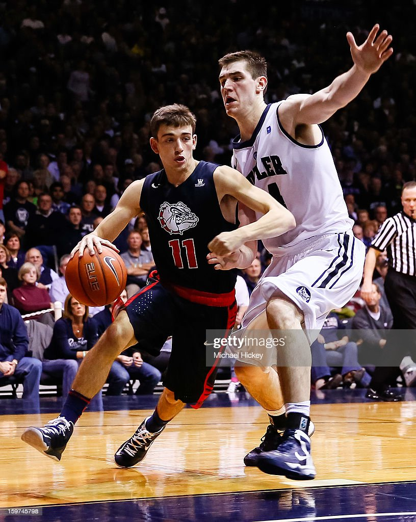 David Stockton #11 of the Gonzaga Bulldogs dribbles past <a gi-track='captionPersonalityLinkClicked' href=/galleries/search?phrase=Andrew+Smith+-+Basketballer&family=editorial&specificpeople=7641849 ng-click='$event.stopPropagation()'>Andrew Smith</a> #44 of the Butler Bulldogs at Hinkle Fieldhouse on January 19, 2013 in Indianapolis, Indiana. Butler defeated Gonzaga 64-63.