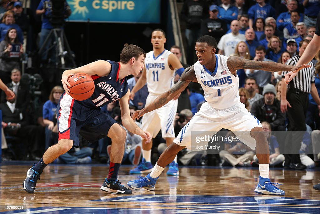 David Stockton #11 of the Gonzaga Bulldogs drives with the ball against Joe Jackson #1 of the Memphis Tigers on February 8, 2014 at FedExForum in Memphis, Tennessee. Memphis beat Gonzaga 60-54.