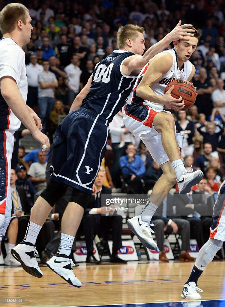 David Stockton #11 of the Gonzaga Bulldogs grabs a rebound against Eric Mika #00 of the Brigham Young Cougars during the championship game of the West Coast Conference Basketball tournament at the Orleans Arena on March 11, 2014 in Las Vegas, Nevada. Gonzaga won 75-64.