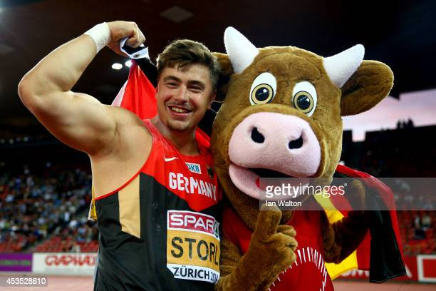 David Storl of Germany celebrates with mascot 'Cooly' as he wins gold in the Men's Shot Put final during day one of the 22nd European Athletics...