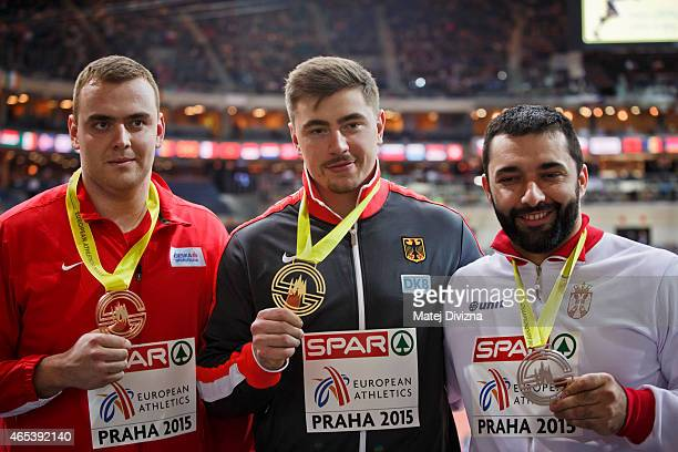 David Storl of Germany Ladislav Prasil of the Czech Republic and Asmir Kolasinac of Serbia pose for photographers after medal ceremony after Shot Put...