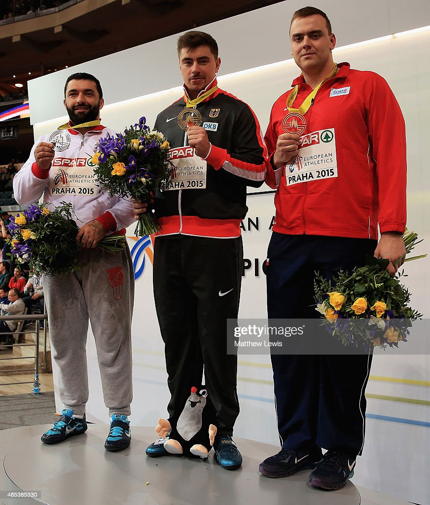 <a gi-track='captionPersonalityLinkClicked' href=/galleries/search?phrase=David+Storl&family=editorial&specificpeople=4399215 ng-click='$event.stopPropagation()'>David Storl</a> (C) of Germany pictured with his gold medal, <a gi-track='captionPersonalityLinkClicked' href=/galleries/search?phrase=Asmir+Kolasinac&family=editorial&specificpeople=6836640 ng-click='$event.stopPropagation()'>Asmir Kolasinac</a> (L) of Serbia pictured with his silver medal and Ladislav Prasil of Czech Republic pictured with his bronze medal after the Mens Shot Putt Final during day one of the 2015 European Athletics Indoor Championships at O2 Arena on March 6, 2015 in Prague, Czech Republic.