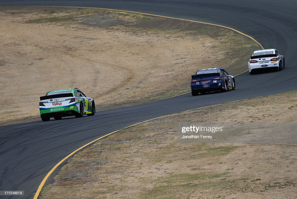 David Stremme, driver of the #30 Lean 1 / Swan Energy Toyota, follows a pack of cars during the NASCAR Sprint Cup Series Toyota/Save Mart 350 at Sonoma Raceway on June 23, 2013 in Sonoma, California.