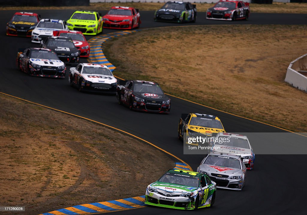 David Stremme, driver of the #30 Lean 1 / Swan Energy Toyota, leads a pack of cars during the NASCAR Sprint Cup Series Toyota/Save Mart 350 at Sonoma Raceway on June 23, 2013 in Sonoma, California.