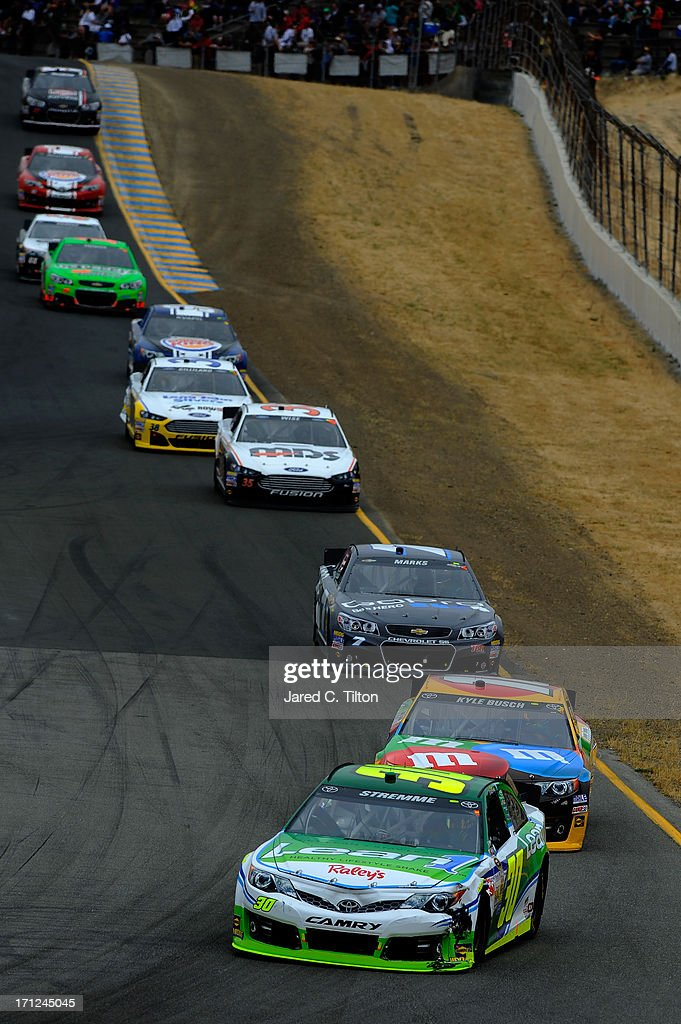 David Stremme, driver of the #30 Lean 1 / Swan Energy Toyota, leads Kyle Busch, driver of the #18 M&M's Toyota, during the NASCAR Sprint Cup Series Toyota/Save Mart 350 at Sonoma Raceway on June 23, 2013 in Sonoma, California.
