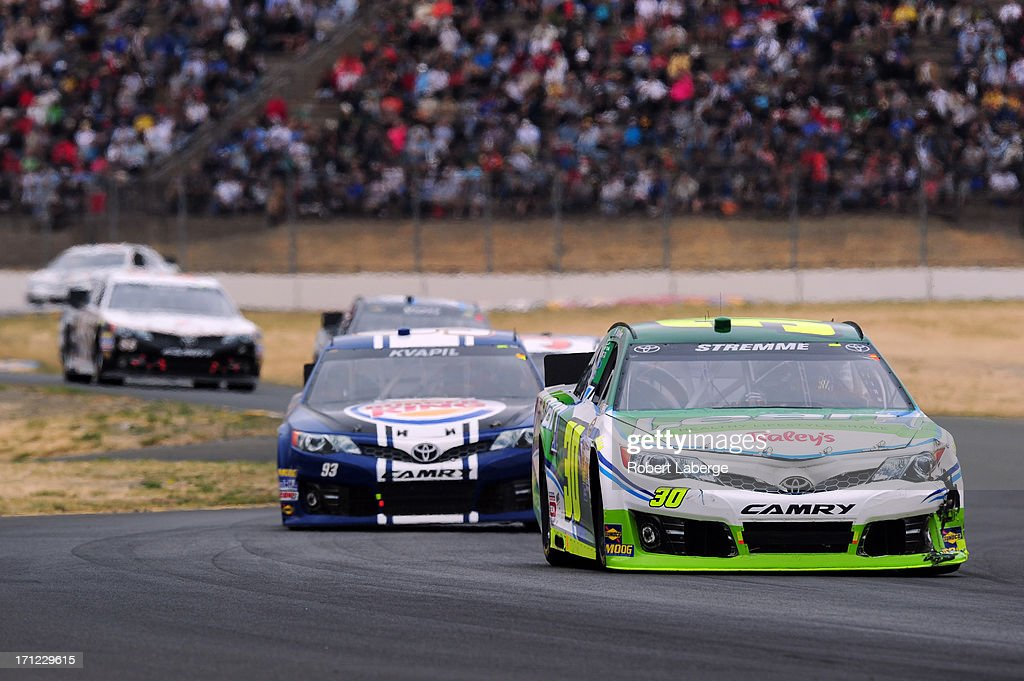 David Stremme, driver of the #30 Lean 1 / Swan Energy Toyota, leads Travis Kvapil, driver of the #93 Burger King/Dr. Pepper Toyota, during the NASCAR Sprint Cup Series Toyota/Save Mart 350 at Sonoma Raceway on June 23, 2013 in Sonoma, California.