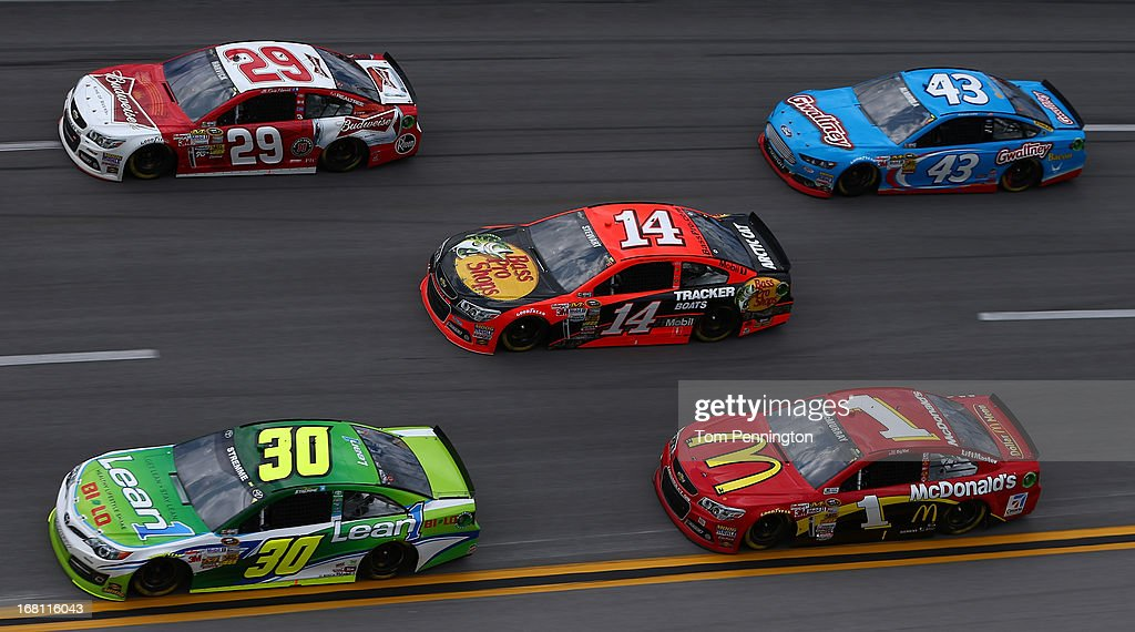 David Stremme, driver of the #30 Lean 1 Toyota, and Kevin Harvick, driver of the #29 Budweiser Chevrolet, lead Tony Stewart, driver of the #14 Bass Pro Shops Chevrolet, Jamie McMurray, driver of the #1 McDonald's Chevrolet, and Aric Almirola, driver of the #43 Gwaltney Ford, through turn four during the NASCAR Sprint Cup Series Aaron's 499 at Talladega Superspeedway on May 5, 2013 in Talladega, Alabama.