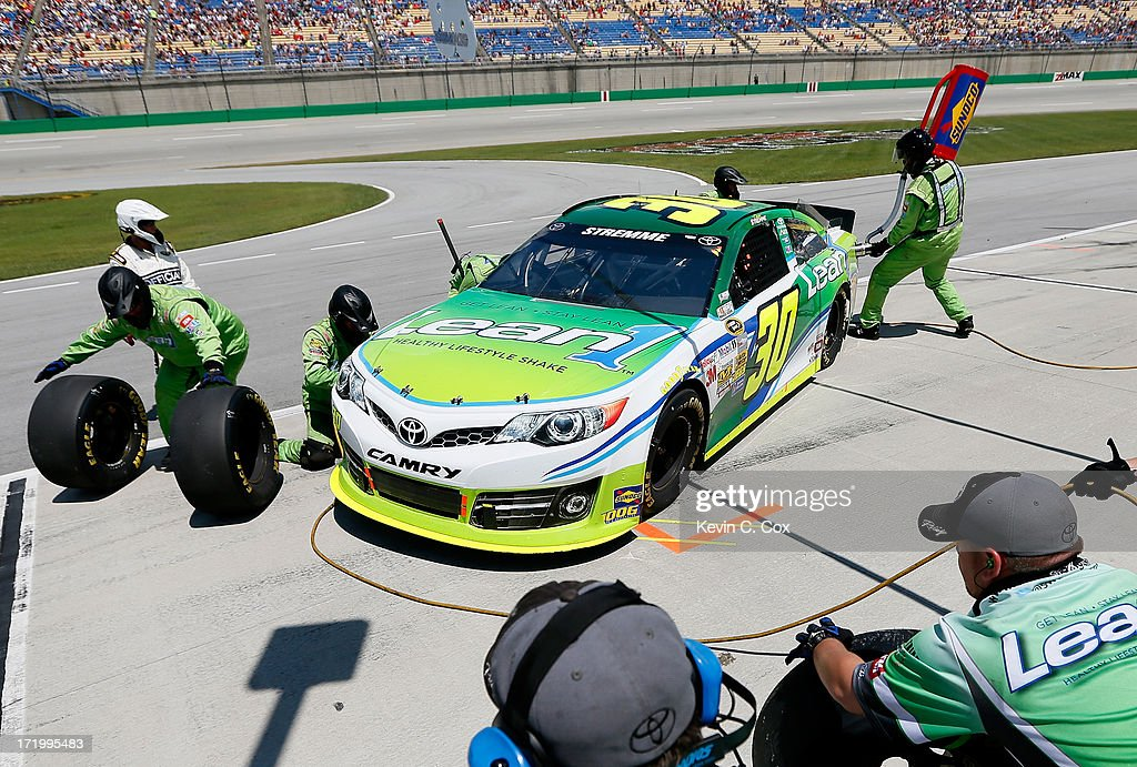David Stremme, driver of the #30 Lean 1 Toyota, comes in for a pit stop during the NASCAR Sprint Cup Series Quaker State 400 at Kentucky Speedway on June 30, 2013 in Sparta, Kentucky.