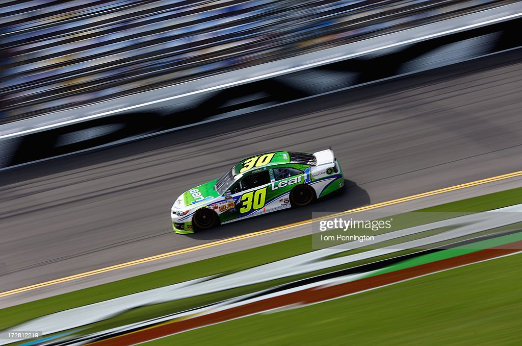 David Stremme, driver of the #30 Lean 1 Toyota, drives on track during practice for the NASCAR Sprint Cup Series Coke Zero 400 at Daytona International Speedway on July 4, 2013 in Daytona Beach, Florida.