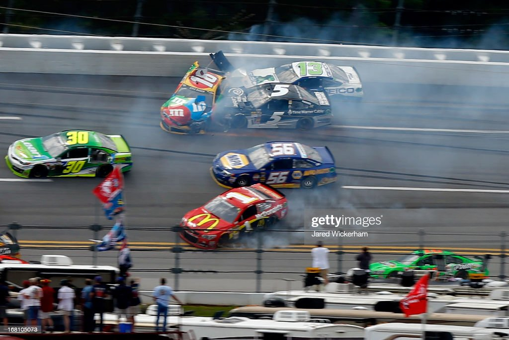 <a gi-track='captionPersonalityLinkClicked' href=/galleries/search?phrase=David+Stremme&family=editorial&specificpeople=241357 ng-click='$event.stopPropagation()'>David Stremme</a>, driver of the #30 Lean 1 Toyota, <a gi-track='captionPersonalityLinkClicked' href=/galleries/search?phrase=Kyle+Busch&family=editorial&specificpeople=211123 ng-click='$event.stopPropagation()'>Kyle Busch</a>, driver of the #18 M&M's Toyota, <a gi-track='captionPersonalityLinkClicked' href=/galleries/search?phrase=Jamie+McMurray&family=editorial&specificpeople=198964 ng-click='$event.stopPropagation()'>Jamie McMurray</a>, driver of the #1 McDonald's Chevrolet, <a gi-track='captionPersonalityLinkClicked' href=/galleries/search?phrase=Martin+Truex+Jr.&family=editorial&specificpeople=184514 ng-click='$event.stopPropagation()'>Martin Truex Jr.</a>, driver of the #56 NAPA Auto Parts Toyota, <a gi-track='captionPersonalityLinkClicked' href=/galleries/search?phrase=Kasey+Kahne&family=editorial&specificpeople=183374 ng-click='$event.stopPropagation()'>Kasey Kahne</a>, driver of the #5 Time Warner Cable Chevrolet and <a gi-track='captionPersonalityLinkClicked' href=/galleries/search?phrase=David+Stremme&family=editorial&specificpeople=241357 ng-click='$event.stopPropagation()'>David Stremme</a>, driver of the #30 Lean 1 Toyota are involved in a wreck during the NASCAR Sprint Cup Series Aaron's 499 at Talladega Superspeedway on May 5, 2013 in Talladega, Alabama.
