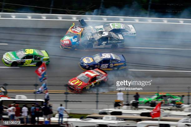 David Stremme driver of the Lean 1 Toyota Kyle Busch driver of the MM's Toyota Jamie McMurray driver of the McDonald's Chevrolet Martin Truex Jr...