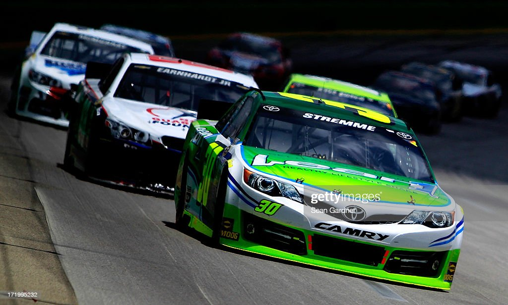 David Stremme, driver of the #30 Lean 1 Toyota, leads a group of cars during the NASCAR Sprint Cup Series Quaker State 400 at Kentucky Speedway on June 30, 2013 in Sparta, Kentucky.