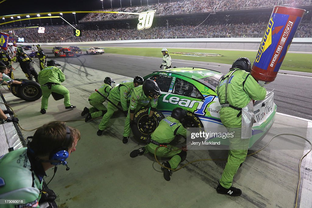 David Stremme, driver of the #30 Lean 1 Toyota , pits during the NASCAR Sprint Cup Series Coke Zero 400 at Daytona International Speedway on July 6, 2013 in Daytona Beach, Florida.