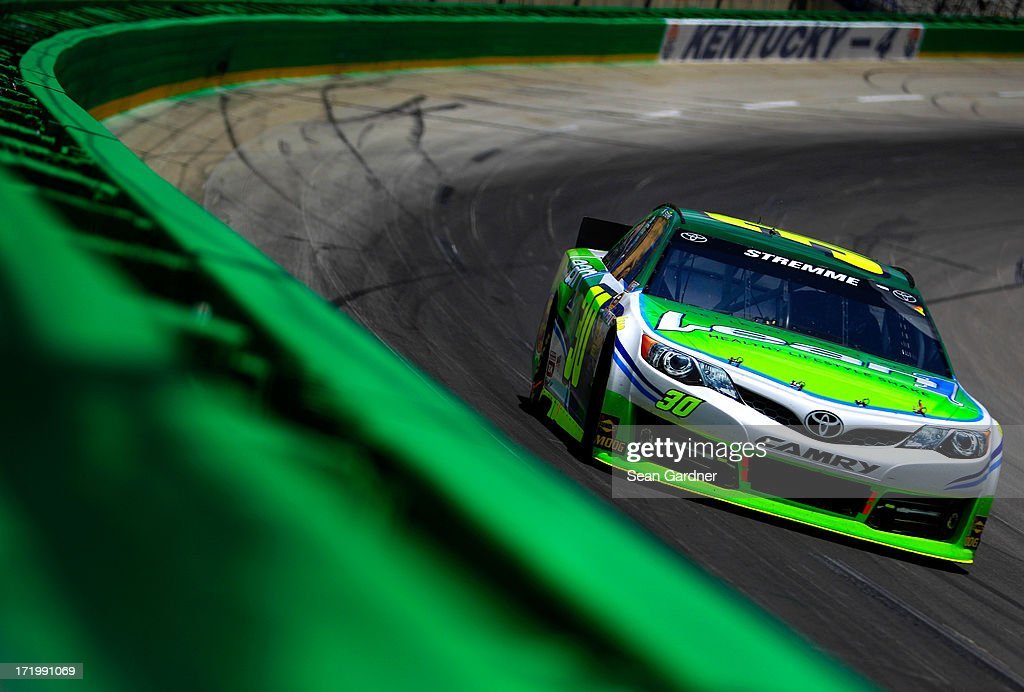 David Stremme, driver of the #30 Lean 1 Toyota, races during the NASCAR Sprint Cup Series Quaker State 400 at Kentucky Speedway on June 30, 2013 in Sparta, Kentucky.