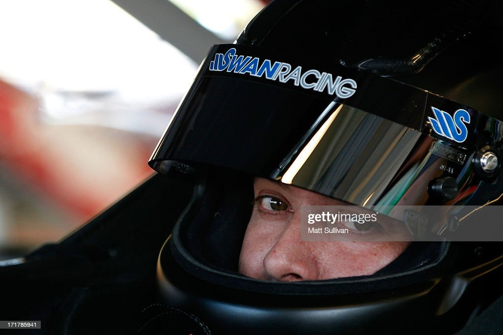 David Stremme, driver of the #30 Lean 1 Toyota, sits in his car during practice for the NASCAR Sprint Cup Series Quaker State 400 at Kentucky Speedway on June 28, 2013 in Sparta, Kentucky.