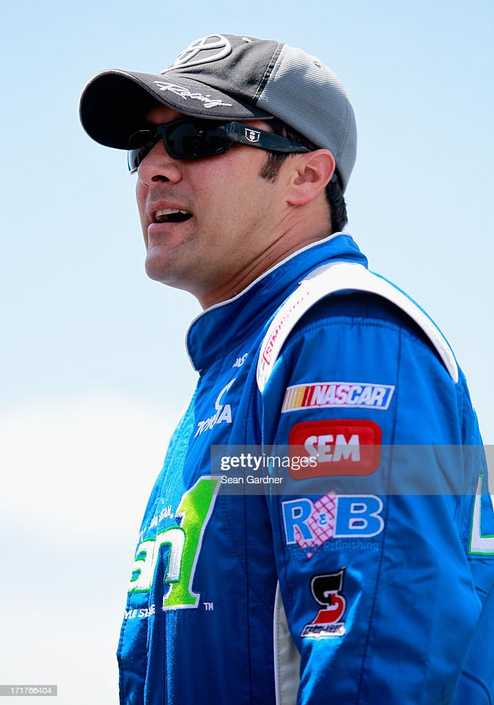 David Stremme, driver of the #30 Lean 1 Toyota, walks in the garage area during practice for the NASCAR Sprint Cup Series Quaker State 400 at Kentucky Speedway on June 28, 2013 in Sparta, Kentucky.