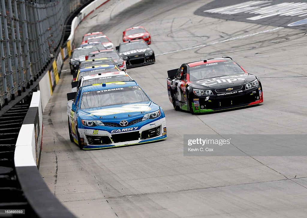David Stremme, driver of the #30 Swan Energy Inception, leads Denny Hamlin, driver of the #11 FedEx Freight Toyota, and a group of cars into turn one during the NASCAR Sprint Cup Series Food City 500 at Bristol Motor Speedway on March 17, 2013 in Bristol, Tennessee.