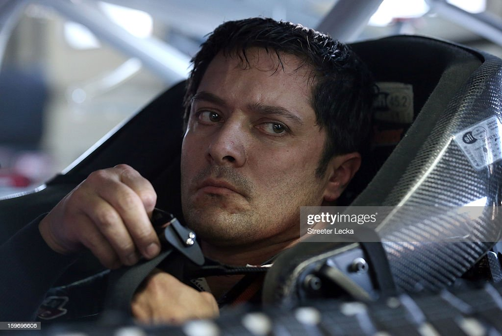 <a gi-track='captionPersonalityLinkClicked' href=/galleries/search?phrase=David+Stremme&family=editorial&specificpeople=241357 ng-click='$event.stopPropagation()'>David Stremme</a>, driver of the #30 Swan Racing, sits in his car during NASCAR Testing at Charlotte Motor Speedway on January 18, 2013 in Charlotte, North Carolina.