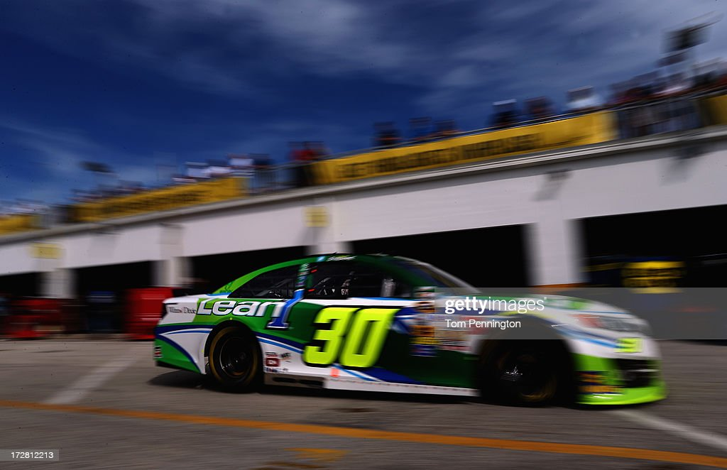 David Stremme, drives the #30 Lean 1 Toyota, drives through the garage area during practice for the NASCAR Sprint Cup Series Coke Zero 400 at Daytona International Speedway on July 4, 2013 in Daytona Beach, Florida.