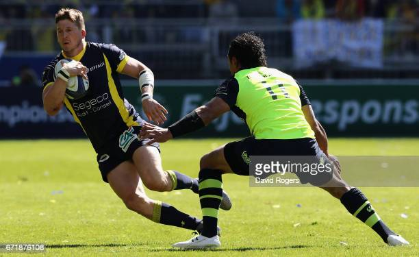 David Strettle of Clermont Auvergne breaks of Isa Nacewa during the European Rugby Champions Cup semi final match between ASM Clermont Auvergne and...