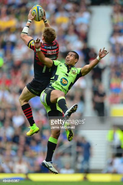 David Strettle of Saracens climbs to reach the high ball ahead of Ken Pisi of Northampton Saints during the Aviva Premiership Final between Saracens...