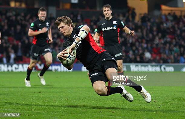 David Strettle of Saracens dives over to score the second Saracens try during the Heineken Cup match between Saracens and Benetton Treviso at...