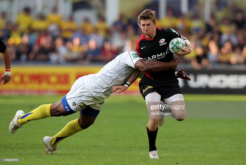 David Strettle of Saracens is tackled by Napolioni Nalaga during the Heineken Cup match between ASM Clermont Auvergne and Saracens at Stade Marcel Michelin on October 9, 2010 in Clermont Ferrand, France.