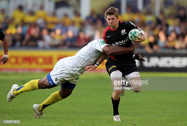 David Strettle of Saracens is tackled by Napolioni Nalaga during the Heineken Cup match between ASM Clermont Auvergne and Saracens at Stade Marcel...