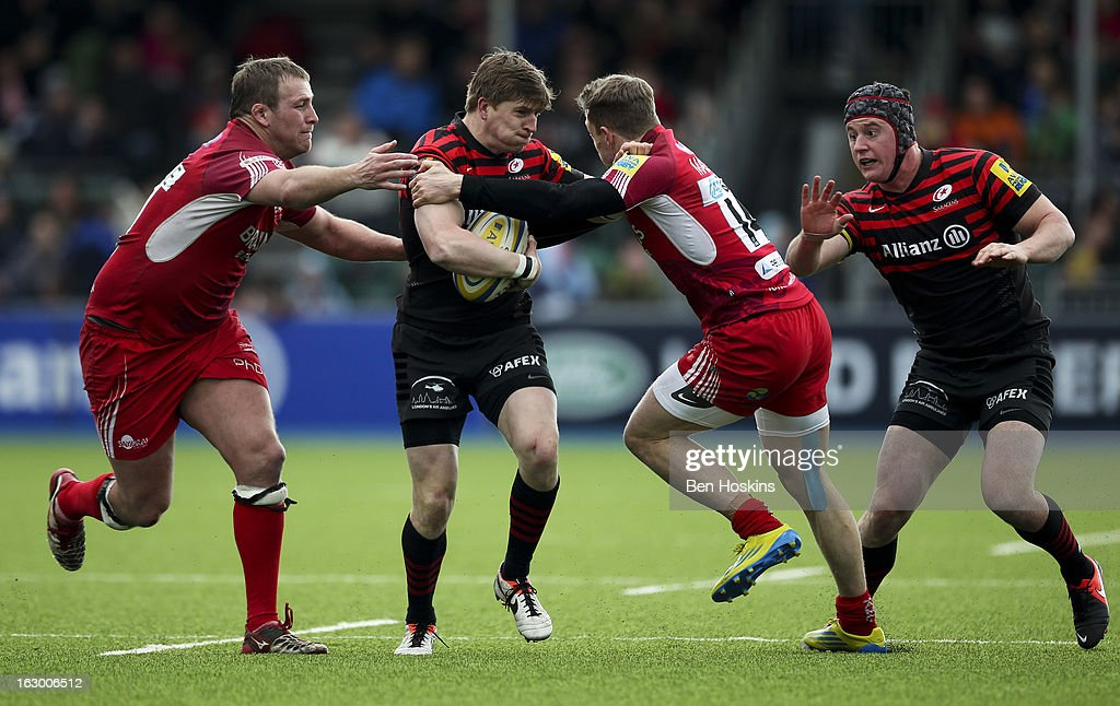 <a gi-track='captionPersonalityLinkClicked' href=/galleries/search?phrase=David+Strettle&family=editorial&specificpeople=594868 ng-click='$event.stopPropagation()'>David Strettle</a> of Saracens is tackled by Phil Mackenzie (R) of London Welsh during the Aviva Premiership match between Saracens and London Welsh at Allianz Park on March 03, 2013 in Barnet, England.