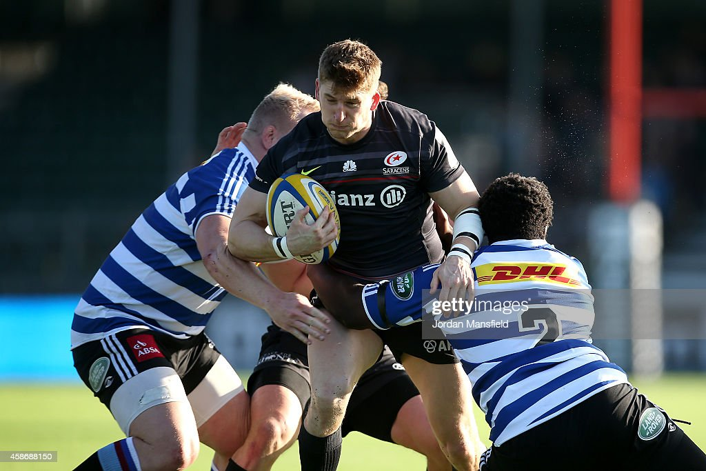 David Strettle of Saracens is tackled by Scarra Ntubeni and Vincent Koch of Western Province during the match between Saracens and DHL Western...