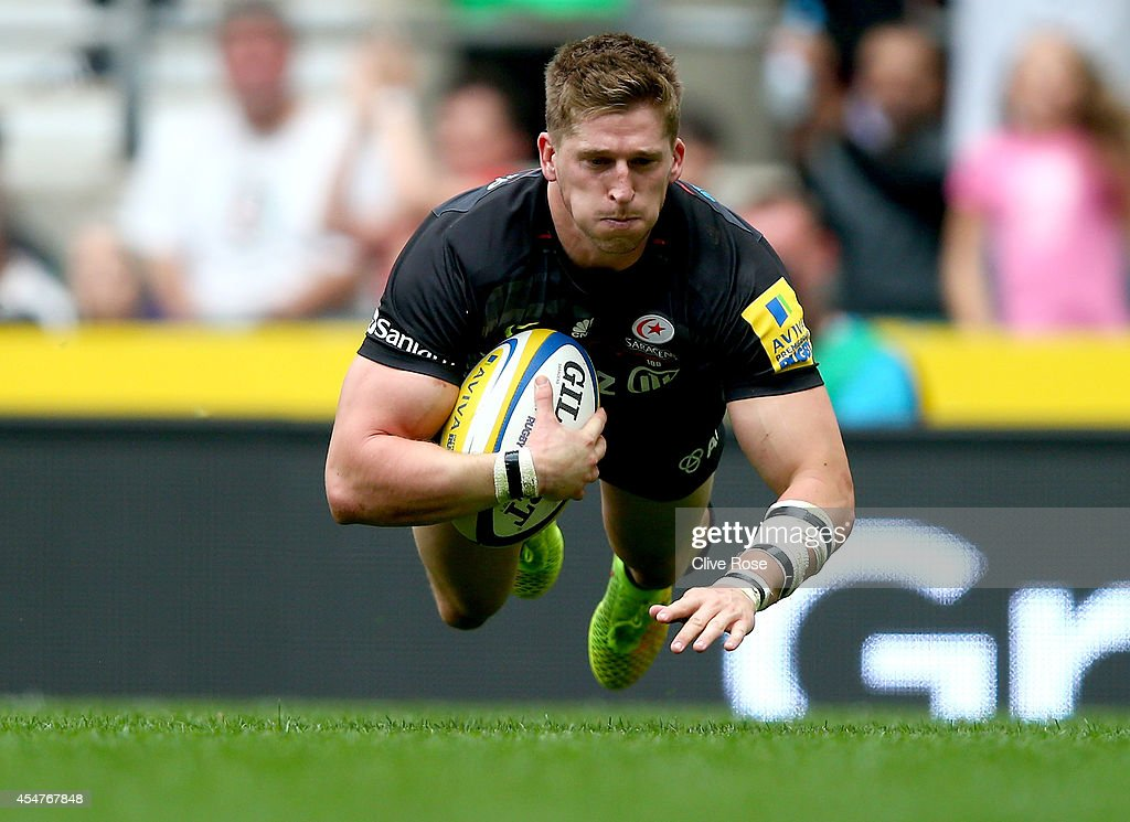 David Strettle of Saracens scores a try during the Aviva Premiership match between Saracens and Wasps at Twickenham Stadium on September 6 2014 in...