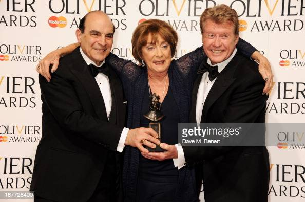 David Suchet Gillian Lynne winner of the Special Award and Michael Crawford pose in the press room at The Laurence Olivier Awards 2013 at The Royal...