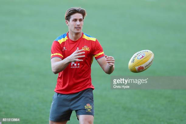 David Swallow catches during a Gold Coast Suns AFL training session at Metricon Stadium on August 15 2017 in Gold Coast Australia