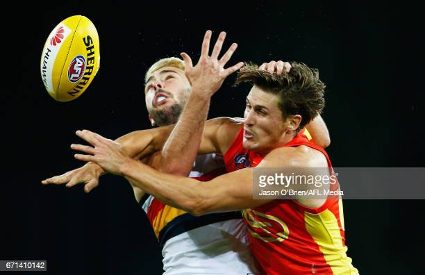 David Swallow of the suns contests posession with Rory Atkins of the crows during the round five AFL match between the Gold Coast Suns and the...
