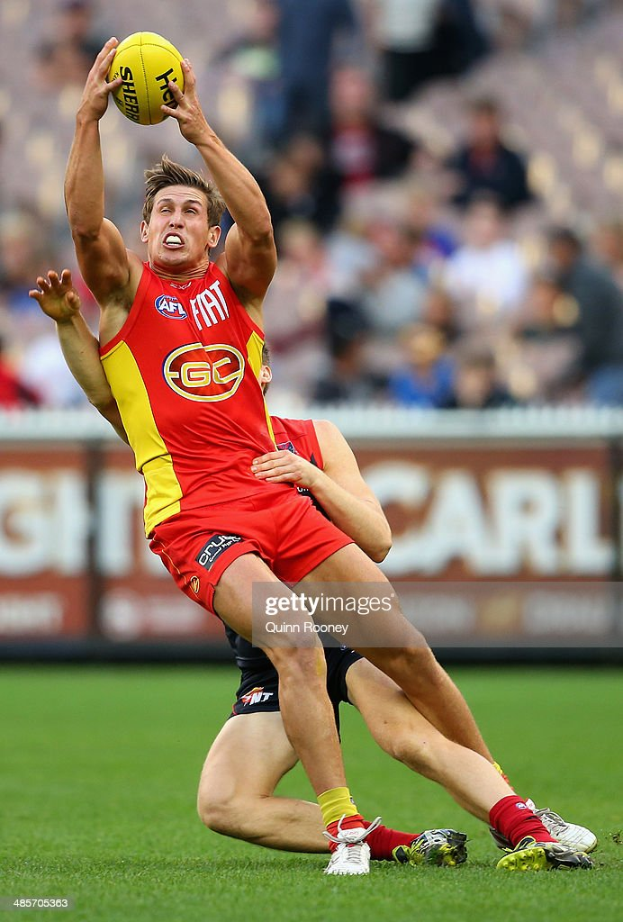 David Swallow of the Suns marks during the round five AFL match between the Melbourne Demons and the Gold Coast Suns at Melbourne Cricket Ground on April 20, 2014 in Melbourne, Australia.