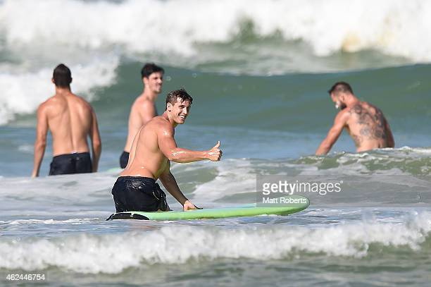 David Swallow smiles after catching a wave surfing during a Gold Coast Suns AFL preseason training session at Casuarina Beach on January 29 2015 in...