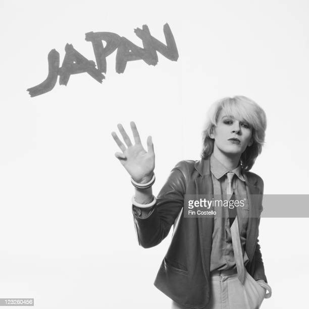 David Sylvian singer with British New Wave band Japan poses with his hand held out in a studio studio portrait against a white background United...