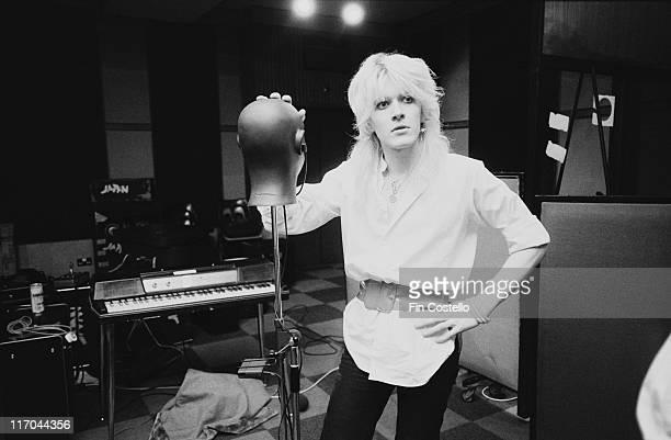 David Sylvian singer with British New Wave band Japan posing beside a mannequin's head on a stand in Morgan Studios a recording studio in Willesden...