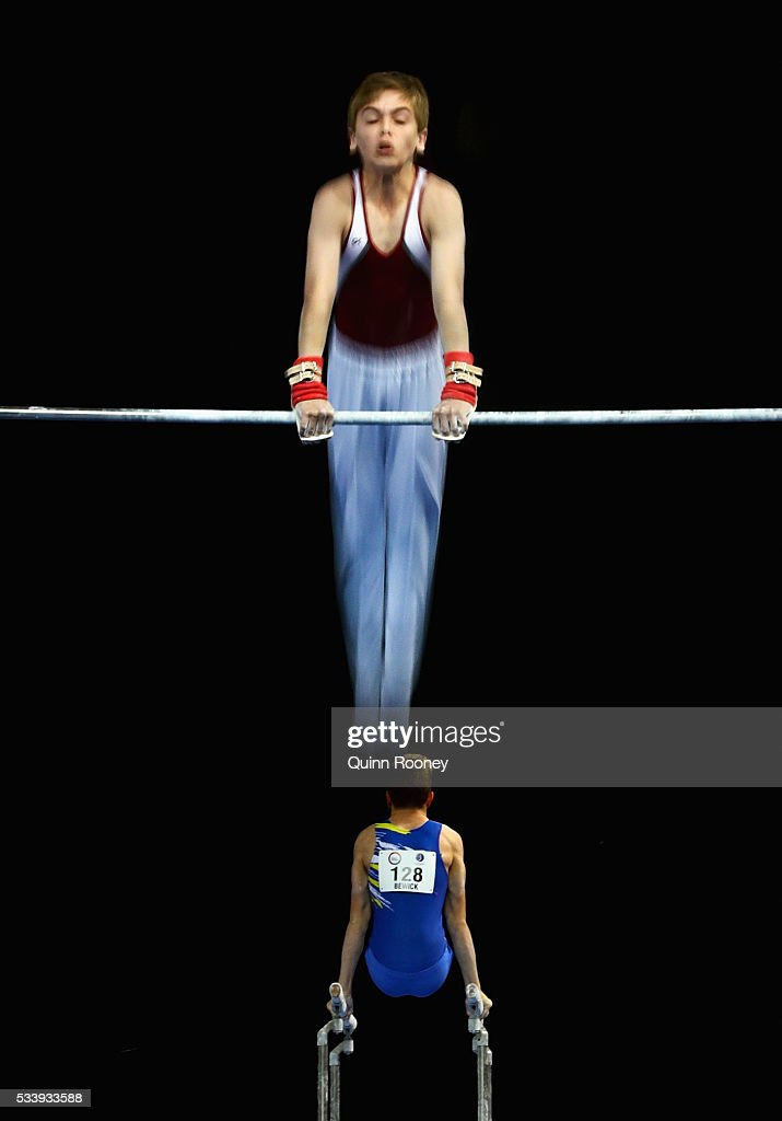 David Tanner of Queensland competes on the high bar as Simon Bewick of ACT competes on the parrallel bars during the 2016 Australian Gymnastics Championships at Hisense Arena on May 23, 2016 in Melbourne, Australia.