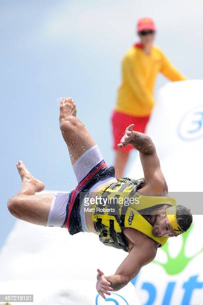 David Taylor jumps into the water during a Gold Coast Titans NRL preseason training session at aquaSplash Water Park on December 17 2013 on the Gold...